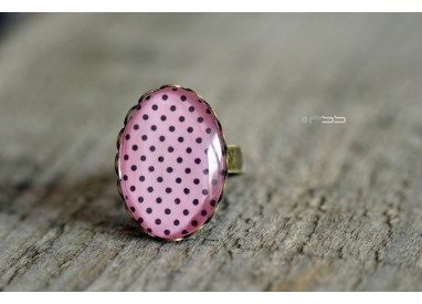Cabochon oval ring Small black polka dots pink background