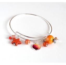 Bracciale donna, giunco argentato, perle arancioni e cabochon
