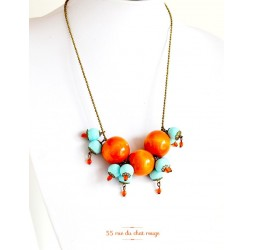 Collier grappe, bois orange, perle bleu tendre, bronze