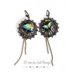 Aretes, largo, de color turquesa de la mariposa asimétrica, joyas para las mujeres de bronce